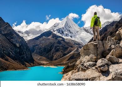 Male Adventurer Looks at the Landscape of Peruvian Mountains in Cordillera Blanca, During Santa Cruz Trekking, Ancash Region, near Huaraz, Adventurous and Touristic Destination in Peru, South America