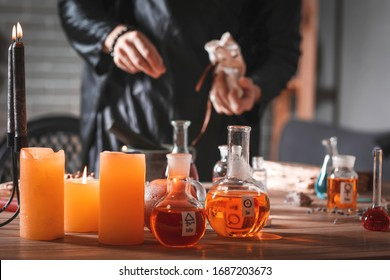 Male alchemist making elixir in laboratory