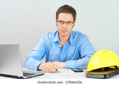 Male architect working at his workplace.