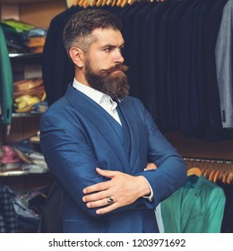 Male arm in blue suit set. Handsome stylish bearded man model posing wearing blue suit. Portrait of successful sexy businessman male, long beard. Modern style. Man's suit: jacket, shirt and tie.