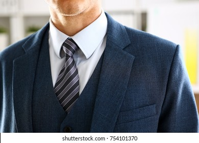 Male arm in blue suit set tie closeup. White collar management job serious move secretary student luxury formal interview executive agent marriage store corporate elegance employment preparation