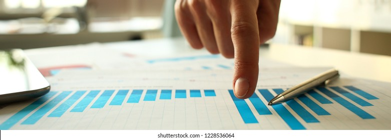 Male arm point finger at important paper on table in office closeup. Paperwork job trade balance bank credit loan money invest payment irs commerce partnership man in suit concept