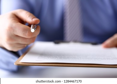 Male arm in suit and tie point in camera tip of silver pen at workplace closeup. Sign gesture read pact sale agent bank job make note loan credit mortgage investment finance chief legal law concept