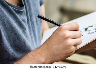 Male artist drawing