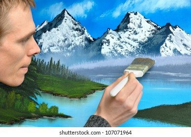 Male artist working with concentrated expression on a beautiful blue landscape painting