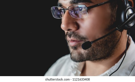 Male Asian customer care operators working night shift in call center