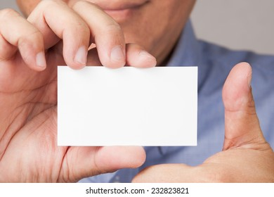 Male Asian model with blank placard and thumb up