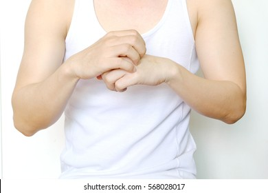 Male Asian skin problem at hand. Scratching their hand .Health concept