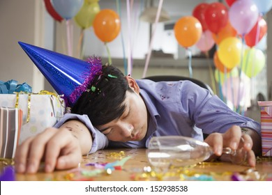 Male Asleep After Party at Office