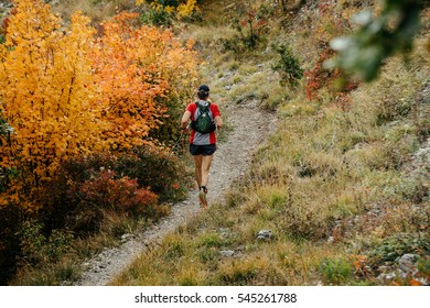 male athlete competes in skyrunning mountain autumn forest