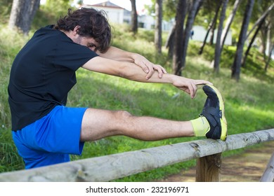 Male athlete doing stretching