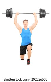Male athlete holding a heavy weight and doing lunges isolated on white background
