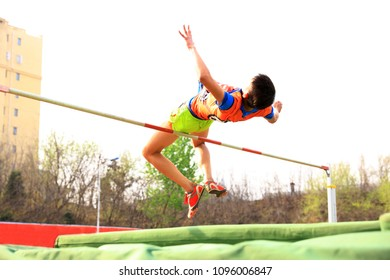 A male athlete is on the high jump