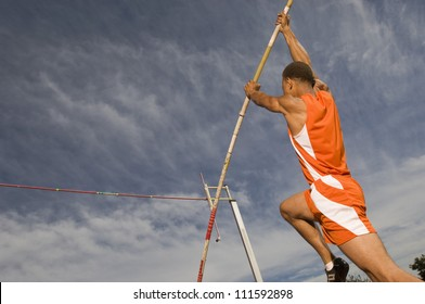 Male athlete performing a pole vault