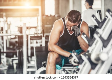 Male athlete suffering a headache or dizziness. Unmotivation in sport and tiredness concept.