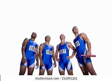 Male athletes in row, smiling, low angle view, cut out