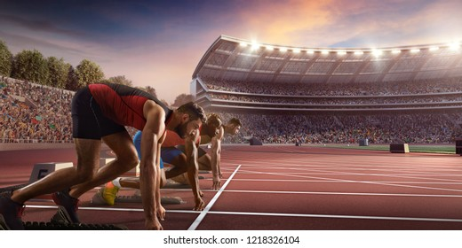 Male athletes sprinting. Three men in sport clothes on starting line prepares to run at the running track in professional stadium