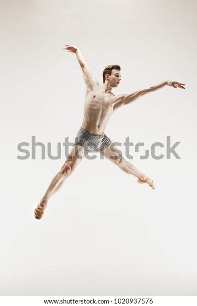 Male Athletic Ballet Dancer Performing Dance Stock Photo (Edit Now)  1020937576