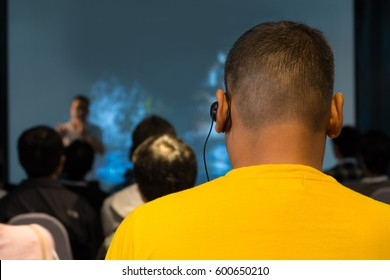 The Male Audience at International Business Meeting or Seminar wearing headphone for online interpreter or Translation as part of Interpretation System