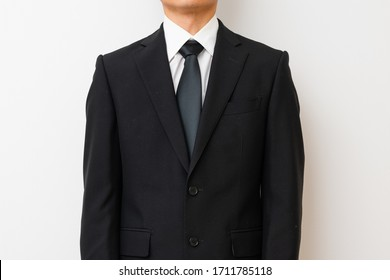 Male back in mourning dress with hands together