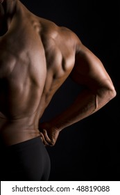 The male back on black background.