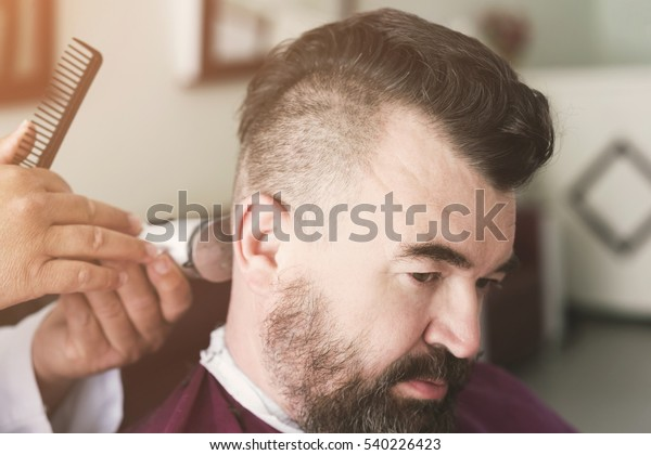 Male Barber Makes Mohawk Hairstyle Using Stock Photo (Edit ...