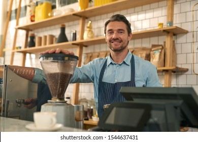 Male barista working on the counter