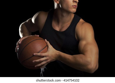 A male basketball player holding basketball.
