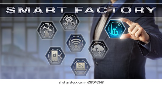 Male blue chip plant manager activating a Smart Factory application. Technology concept for digital manufacturing, cyber physical systems, industry 4.0 and data exchange via internet of things.