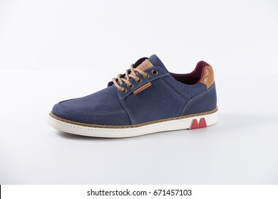 Male Blue Sneaker on White Background, Isolated Product, top view, Studio.