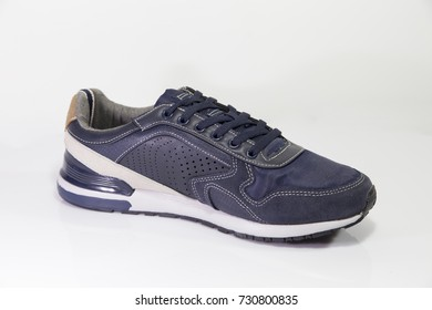 Male Blue Sneaker on White Background, Isolated Product.