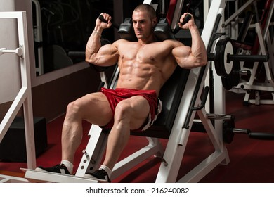 Male Bodybuilder Doing Heavy Weight Exercise For Legs