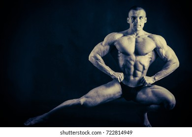 male bodybuilder is  posing