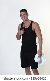 male bodybuilder with a skipping rope around his neck after a good work out holding a towel