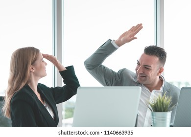 Male boss Hi five to female worker for success