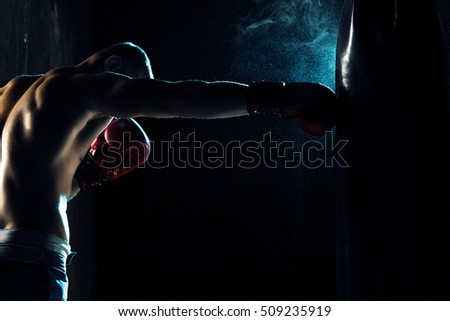 Male boxer boxing in