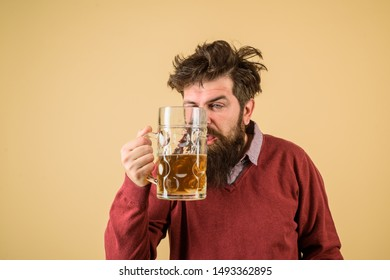 Male brewer holds glass with beer. Oktober fest. Tasting fresh brewed beer. Brewer holds glass with craft beer. Brewery concept. Oktoberfest festival. Alcohol. Man with beer of mug. Barman. Brewer.