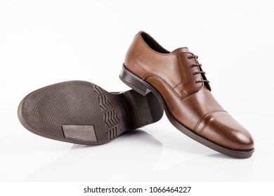 Male brown leather elegant shoe on white background, isolated product, comfortable footwear.