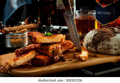 Male brutal dinner . Meat, whiskey and cigars, herbs and bread