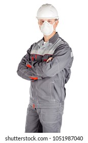 male builder in white helmet and mask with crossed arms over white wall background. repair, construction, building, people and maintenance concept.