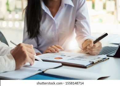 A male business consultant describes a marketing plan to set business strategies for women business owners witch using tablet. business planning and  researching concept.