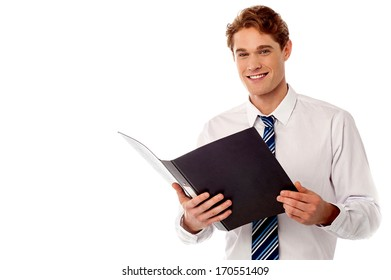 Male business executive reviewing his company documents