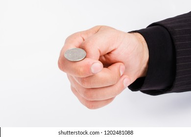 male business hand lot tossing a coin