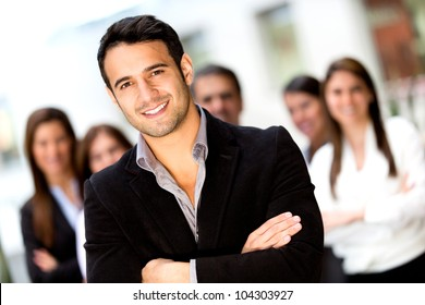 Male business leader looking confident with a group