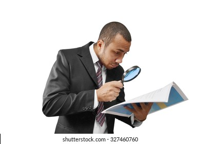 male business man examining document with magnifier
