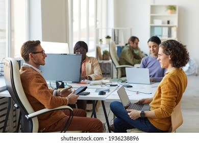 Male Business Manager Talking to Employee