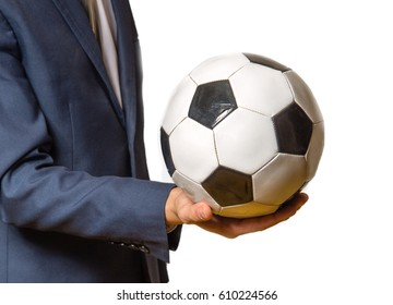 male businessman in suit holding soccer ball