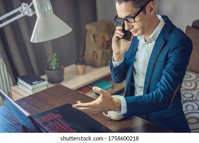 A male businessman is working remotely in home office mode. Online communication with employees and project management in a comfortable workplace