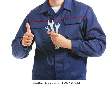 Male car mechanic showing thumb-up on white background