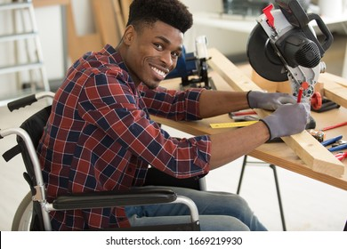 male carpenter in a wheelchair